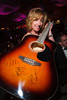 Ronda Wolff wins the bid for an Earth, Wind & Fire-signed guitar.  The 2012 NightShine Gala, benefiting the Denver Health Foundation, at the National Western Events Center in Denver, Colorado, on Saturday, April 28, 2012.<br /> Photo Steve Peterson