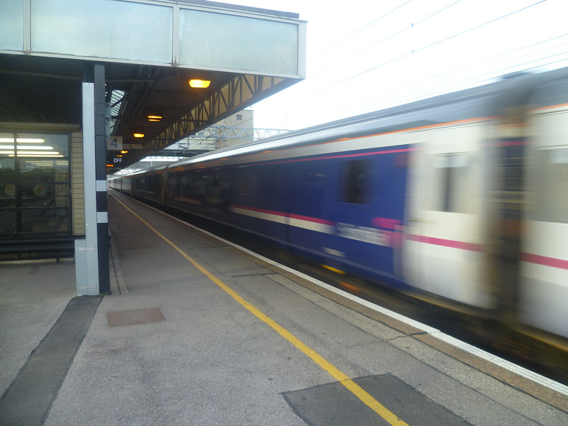 The First ScotRail Caledonian Sleeper passing Milton Keynes Central.
