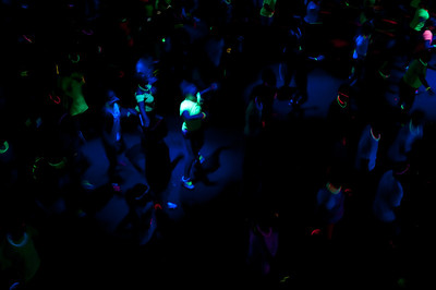 Students participate in a Black Light Zumba party in Stuart Hall in the Tucker Student Center on Friday August 31, 2012.