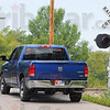Tribune-Star/Jim Avelis<br /> Perimeter: An unmarked police vehicle sets up a perimeter at railroad tracks near the site on Head Road where a flatbed truck was abandoned after running the Clinton police chief off the road Thursday morning.
