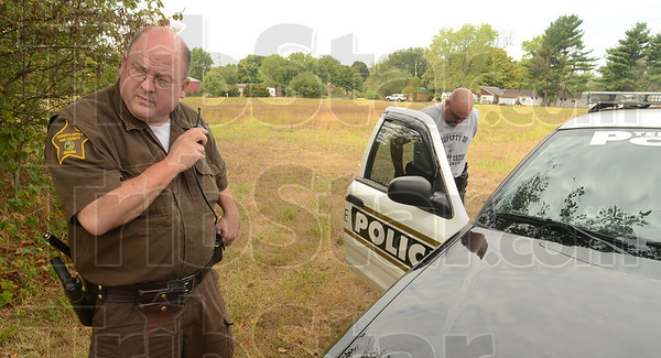Tribune-Star/Jim Avelis<br /> Instructions: Vigo County sheriff's deputy Tim Taylor gets instructions for a search area for Terre Haute K-9 officer Terry John. The two were involved in the search for the driver of a truck that ran the Clinton city police chief off the road Thursday morning.