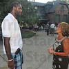 Tribune-Star/Jim Avelis<br /> Back in town: Greg Oden chats with Tami Smith at the barbecue at Jim And Cindy Martin's home Thursday evening. Oden is in Terre Haute to take part in the Travis Smith memorial golf tournament.