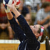 Tribune-Star/Jim Avelis<br /> All set: Terre Haute North's Anna Taylor sets the ball for a teammate in the Patriot's match with Northview Thursday night.