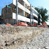 Tribune-Star/Jim Avelis<br /> Through the years: A drop of about a foot shows the previous pavings of Wabash Avenue at 14th street. The compacted white rock forms the new roadbed to the right.