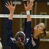 Tribune-Star/Jim Avelis<br /> Point: Northview hitter McKenzi Kumpf gets a kill past the reach of Terre Haute North defender Anna Taylor in the second game of their match Thursday night.