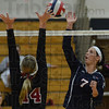 Tribune-Star/Jim Avelis<br /> Spike: Terre Haute North's Danielle Krupa tries to spike the ball past the block of Northview's Morgan Stearly in the first game of their volleyball match Thursday night in the Patriot gym.