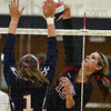Tribune-Star/Jim Avelis<br /> Big game: Northview hitter Shelby Morris(13) had a big game for the Knights against Terre Haute North. Defending is Patriot Anna Taylor.