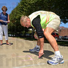 Tribune-Star/Jim Avelis<br /> Not hopscotch: Marla Flowers and Pat Martin work together to mark the spots for public toilets at 8th and Wabash Thursday afternoon. The work was being done in preparation for Saturday's Downtown Block Party.