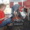 Tribune-Star/Jim Avelis<br /> Checking the list: Red Cross volunteers Betty Moote and Jim Legg work together going through a checklist before heading to Florida to help with relief efforts should Tropical Storm Issac create the need.