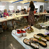 """Tribune-Star/Joseph C. Garza<br /> Until you walk a mile...: Joan Knies of the Crisis Connection explains a recent project that played off of the saying """"Until you walk a mile in their shoes"""" during her presentation Thursday at the Clay County YMCA in Brazil."""