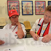 Tribune-Star/Jim Avelis<br /> Paperwork: Red Cross volunteers Wendy Taylor and Janice Hawkins work together to fill out paperwork for their trip to the Tamps Florida area. They'll help provide manpower in the event Tropical Storm Issac creates the need.