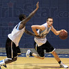 Hands off: Indiana State's #13 Jake Odum brushes away the hand of his defender during Thursday's practice at the ISU Arena.