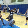 Face plant: Indiana State's T.J. Bell goes face first to the floor after tumbling over Mike Samuels (L) during Thursday's men's basketball practice. Watching the action is #22 Brandon Burnett.