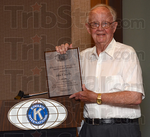Tribune-Star/Jim Avelis<br /> Recognized: John T. Newlin with his Handclasp award plaque he received at a Kiwanis luncheon Thursday.