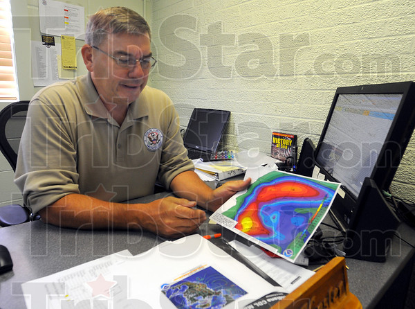 Tribune-Star/Jim Avelis<br /> Forecasts: J.D. Kesler, Deputy Director and Public Information Officer for the Vigo County Emergency Management Agency talks about possible tracks for the remains of hurricane Issac and their impact on the Wabash Valley. His agency is in a pre-staging mode, preparing for what may come over the weekend.