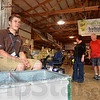 Tribune-Star/Jim Avelis<br /> Manpower: Parke County native and Future Farmers of America member Cameron Frazier watches over the drink sales at the entrance to the FFA building at the Indiana State Fair Friday afternoon. Frazier hopes to go into Ag education.