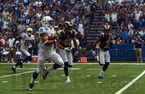 He's gone: Indianapolis running back Donald Brown (31) outruns the St. Louis defense to score the Colts' first touchdown on the team's first offensive play Sunday in Indianapolis.