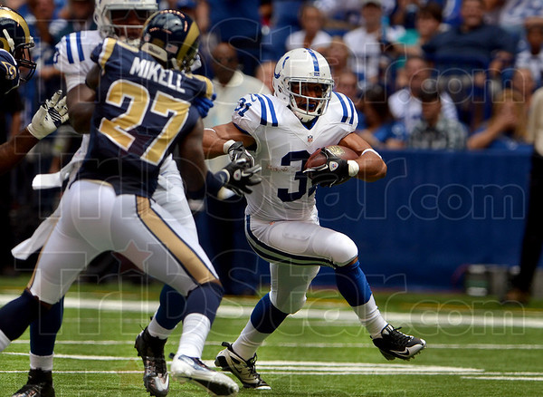 Through the gap: Indianapolis running back Donald Brown runs through the St. Louis defense on his way to scoring on the Colts' first offensive play Sunday in Indianapolis.