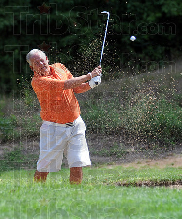 Master blaster: Tournament leader Dave Brown hits from the bunker during match action of the men's senior championship at Hulman Links Sunday afternoon.