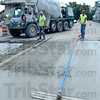 Tribune-Star/Jim Avelis<br /> Smooth ride: The driveway into Southland shopping center gets a smooth finish from a Feutz Construction Co. worker Wednesday afternoon. Work expected to be finished by November 12th is well over a month ahead of schedule.