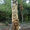 Carving: A giant wood carving greets visitors to the sacred burial grounds in Sullivan County.
