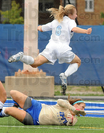 Missed: Indiana State's #6 Syldney Lovelace jumps over the IPFW goalee as she takes a shot attempt that just misses being a goal in the first period of play Sunday.
