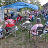 Gathering: The Holy Rosary Catholic Church of Seelyville sponsored a fundraiser Blue Grass Festival Saturday afternoon attempting to raise money to keep the church open.