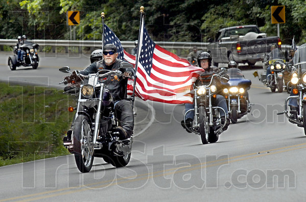 Patriot rider: A motorcyclist participating in the annual Govern's Ride sport the American Flag on the rear of his Harley Davidson as he enters the Shakamak State Park Friday afternoon.