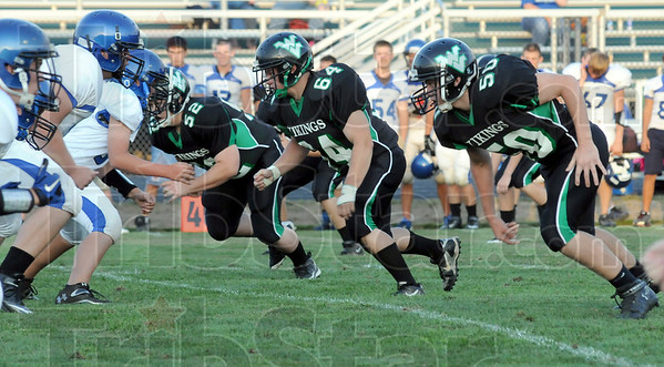 Pressure: West Vigo defenders Ryan Hackett (52), Tyler Bell (64) and Joshua Beasley (50) put pressure on the ball during scrimmage action against North Vermillion.