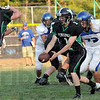 Hand-off: West Vigo quarterback #1 Jimmy Maples prepares to hand the ball to #44 Dakota Short during Friday's scrimmage against North Vermillion.