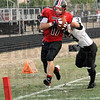 Score: South's #17 Nic Keller crosses the goal line to score during Friday's scrimmage action against Northview's #3 Kelly Hawkins.