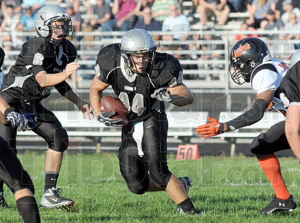 Hand-off: Northview quarterback #6 Tucker Stewart hands the ball to #44 Jesse Miller during early action against Broad Ripple.