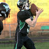 Return: West Vigo's #5 Hunter Voils catches the ball during a punt return against Evansville Harrison Friday evening.