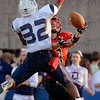 Tribune-Star/Joseph C. Garza<br /> The call: pass interference: Terre Haute South's Tyler Seibert gets a hand on a Danny Etling pass but can't haul it in as he is covered by North's Kai Stratten during the Braves' loss to the Patriots Friday at Memorial Stadium.