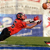 Tribune-Star/Joseph C. Garza<br /> Terre Haute South's Jacob Johnson stretches out for a pass but it was teammate Logan Steward that came away with the catch during the Braves' game against North Friday at Memorial Stadium.