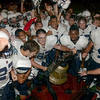 Tribune-Star/Joseph C. Garza<br /> For Tre: Terre Haute North's Alan Grayless, center, rings the Victory Bell for late teammate Tre Fletcher as the Patriots celebrate their victory over South Friday at Memorial Stadium.
