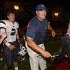 Tribune-Star/Joseph C. Garza<br /> Terre Haute North coach Chris Barrett celebrates his team's victory over South Friday with a few tugs of the Victory Bell's rope at Memorial Stadium.