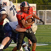 Tribune-Star/Joseph C. Garza<br /> Picked off: Terre Haute South's Jonathan Weakley is tackled after he intercepted a pass by Terre Haute North quarterback Chris Barrett II during the Braves' loss Friday at Memorial Stadium.