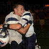 Tribune-Star/Joseph C. Garza<br /> Emotional win: Terre Haute North's Vasco Billberry is hugged by teammate Chris Barrett II after the Patriots defeated South Friday at Memorial Stadium.