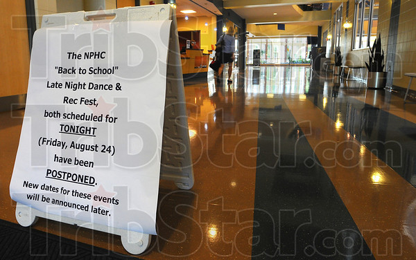 Tribune-Star/Jim Avelis<br /> Postponed: A sign in the Indiana State University recreation center notified students of the canceled activities Friday evening.
