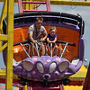 Free fallin' fun: Five-year-old Bradee McDonald, right, of Brazil enjoys one of the rides at the 2012 Indiana State Fair in Indianapolis Friday. Riding with Bradee is her dad Scott McDonald's cousin, William Lambermont, 14, of Las Vegas.
