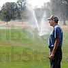 Watering hole: Rea Park groundskeeper Don Alumbaugh watches the watering of a fairway on the course Friday afternoon. The course has absorbed over 14 million gallons of water during the drought.