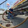 Fuel delivery: Tom Scott of the Spence/Banks Oil Company delivers three thousand gallons of gasoline to the 500 Express station at 25th and Hulman Friday afternoon. Prices have jumped to $3.95 per gallon in recent days.