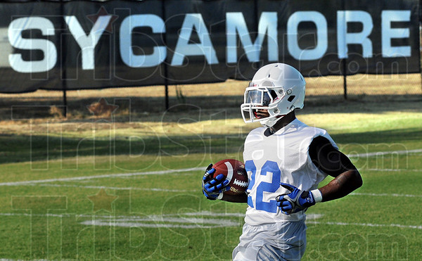 Sycamore: Indiana State All-American running back Shakir Bell carries the pigskin during Friday's practice at Memorial Stadium.