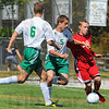 Tribune-Star/Jim Avelis<br /> Drawing a crowd: West Vigo defenders Peyton Freeman(6) and Connor Lindsay converge on Terre Haute South forward Max Cooper as the schools compete in the soccer jamboree.