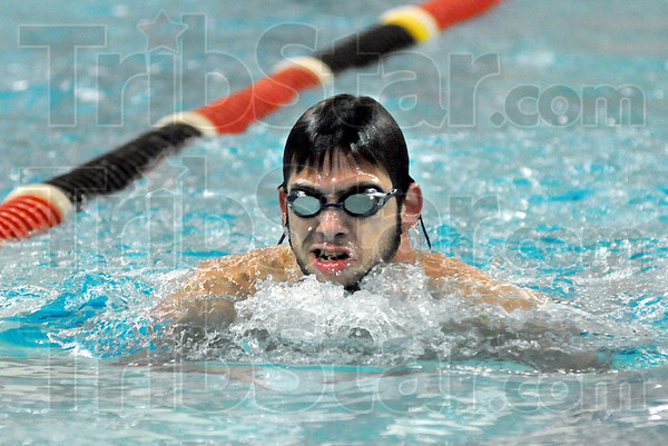 Gulp: Evan Austin takes a gulp of air while swimming the breaststroke Thursday during his workout.