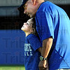 Family man: Indiana State University head football coach Trent Miles gives some attention to his daughter during Saturday's scrimmage at Memorial Stadium.