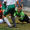 Tribune-Star/Jim Avelis<br /> Stopped: West Vigo goal keeper Nathan Augustus dives to cover the ball in the Viking's match with Terre Haute South in the soccer jamboree.