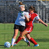 Tribune-Star/Jim Avelis<br /> Control: West Vigo's Kaitlyn Benefiel and Terre Haute South's Kayla Serrato fight for control of the ball in their quarter of action in the Soccer jamboree.