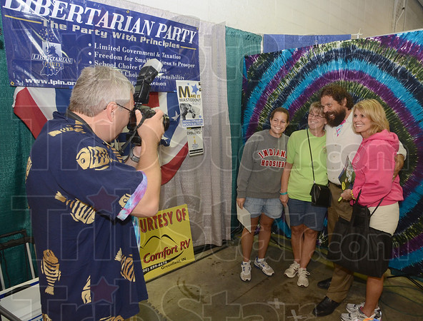 "Tribune-Star/Jim Avelis<br /> Like us: A Boneham for Governor staffer takes a picture of Rupert Boneham with fans at the Indiana State Fair Friday afternoon. The ""Survivor' star is running on the Libertarian ticket for Governor of Indiana."